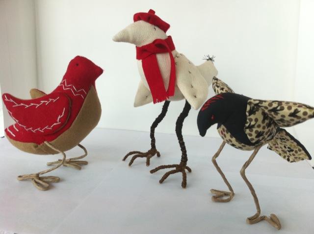 Three bird black white red flock