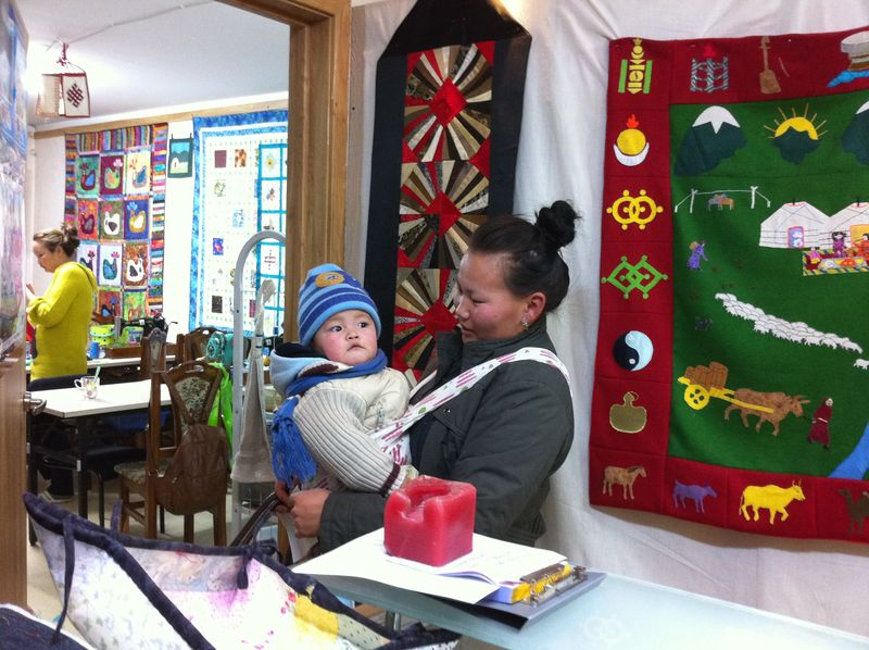 Mongolian quilter with child